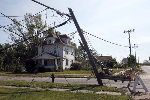Photo of power lines down in front of a house