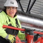 Image of female apprentice on a lift